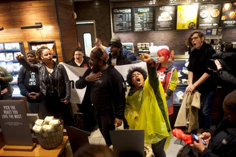 Protestors demonstrate inside a Center City Starbucks where two black men were arrested in Philadelphia Pennsylvania U.S