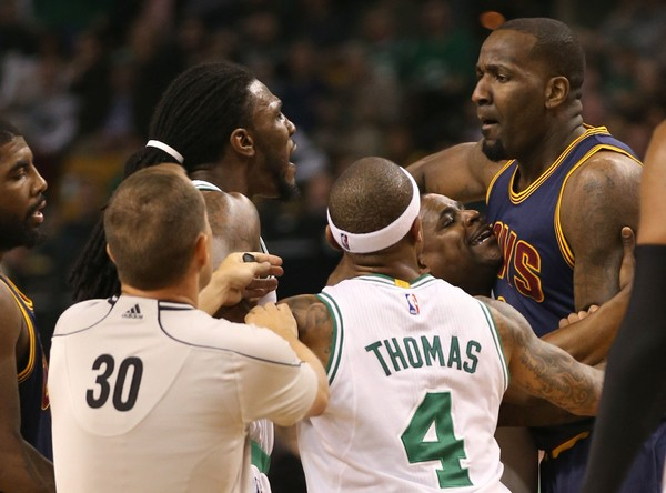 Cleveland Cavaliers center Kendrick Perkins scuffles with Boston Celtics forward Jae Crowder, after a play in which Perkins was called for a flagrant foul. TD Garden on Sunday