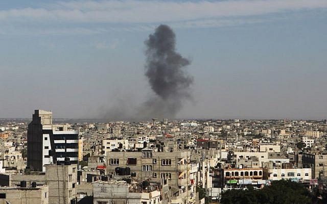 Smoke rises following an Israeli air strike in Rafah in the southern Gaza Strip